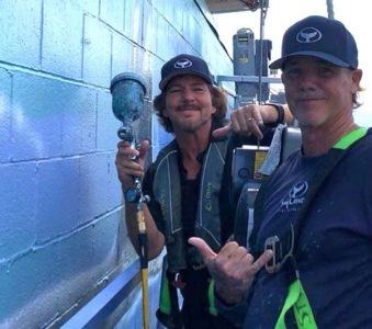 Eddie Vedder helps artist Wyland to paint a mural on Seattle's Edgewater Hotel