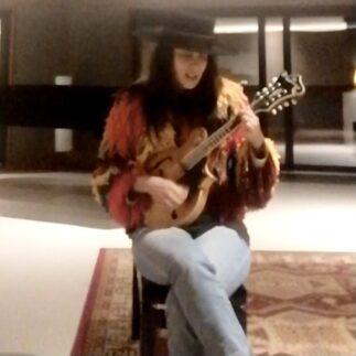 Watch Delila Paz sing a stripped down version of Eddie Vedder's Rise